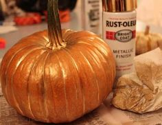 Pumpkin, metallic gold spray paint! Love this for Halloween front porch decor!