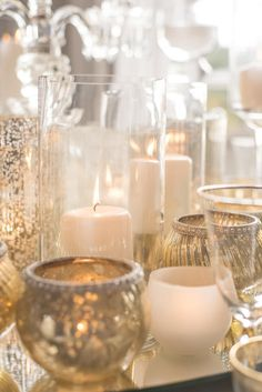 Our luxury green, gold and white wedding styling and design at the stunning North Of England Boutique Wedding Venue Acklam Hall. Our crystal candelabra, gold lanterns and votives, gold cutlery and charger plates, make a statement alongside our exotic green and white wedding. Fine Art Images Georgina Harrison Photography
