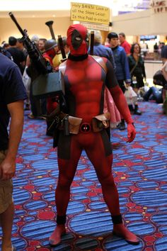 Best Deadpool costume. If the airbrushing wasn't enough awesome, he's got the little yellow box.