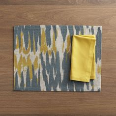 Add sophistication to your dining table with the quick addition of a fabric place mat ($6).
