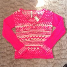 Neon Pink Sweater Very cute and very neon pink and cream colored sweater. NEVER been worn. NWT. Material is soft and some what stretchy.  XS but can fit a true S! Aeropostale Sweaters Crew & Scoop Necks