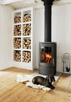 stacks of firewood in modern white shelves 10 Rustic Design Details Anyone Could Add to Home Estilo Interior, Firewood Storage, Firewood Holder, Stove Fireplace, Basement Fireplace, Cozy Fireplace, Wood Burner, Built In Storage, Rustic Design