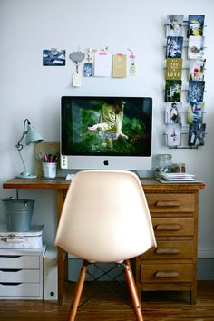 Caroline Briel´s home office. Love the idea of the postcards holder.