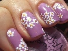 Nail art:    Violet polish with daisies nail art design