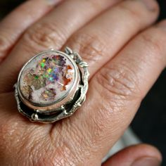 THIS LOVELY RING IS RESERVED FOR LARISSA... PLEASE DONT PURCHASE UNLESS YOU ARE SHE!! THANKS WOW!!! This stone is just amazing!!! A rare find with total rainbow... this large and bold colourful ring is a true statement piece!! handcrafted with precision and love with leaves, dew drops and