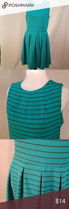 Mossimo striped dress Great teal dress with dark grey stripes.  Great pleat detail at the neckline and box pleats in the skirt gives this a great fit.  Plus, POCKETS!  Statement zipper in the back and knew length. From pet and smoke free home. Mossimo Supply Co Dresses