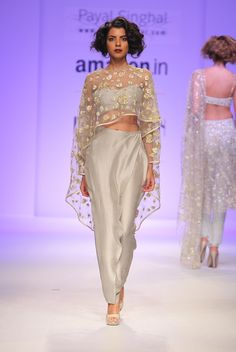 Payal Singhal Indian Wear Collection : : Eve Cape Set : Pale Grey Rose Embroidered Cape Worn With A Bustier & Low Crotch Overlay Pants. Indian Dresses, Indian Outfits, Mehendi Outfits, Ethnic Fashion, Indian Fashion, Women's Fashion, Indian Crop Tops, Grey Crop Top, Vogue