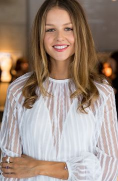 JAN LOGAN - Isabelle Cornish wearing 9ct gold triple pearl ring, 9ct gold amethyst Carly bangle and ring.