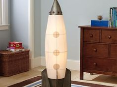 PBK rocket floor lamps but looks like a DIY using an inexpensive ikea lamp would work too