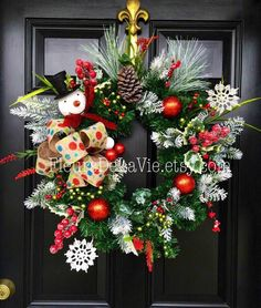 A personal favorite from my Etsy shop https://www.etsy.com/listing/254821718/christmas-wreath-for-front-door-front