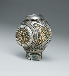 Exquisite details:  ca. 950 Although a fragment, brooch terminal is artistically & technically one of the finest works to survive from the Viking. The silver sphere was hollow cast & virtually its entire surface decorated with niello - early Viking style known as Jellinge/Mammen. Raised, twisted gold wire forms a quatrefoil ring-knot pattern on a raised, circular gold panel. Two adjacent triangular gold panels are filled with studs & one has a medallion in its center w/ serpentine tendrils.
