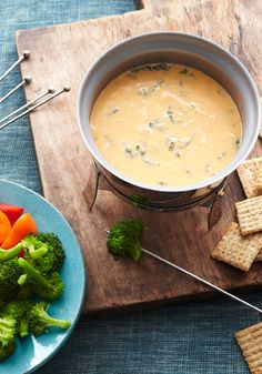 Garlic, Spinach & Cheddar Fondue – We've translated your favorite spinach dip into a melty cheddar fondue for a winning combo at a party—or anywhere else.