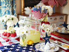 ❥ I didn't realize a real flag was used as the table cloth--this is NOT OK!!!   This is NOT an appropriate tablecloth.  ~From HGTV:Beyond Red, White and Blue.    While patriotic colors should be prominent in a July Fourth table setting, incorporating summery splashes of yellow and green will freshen up the look.