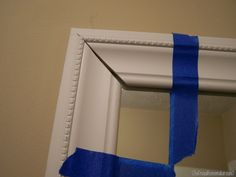 How to frame your bathroom mirrors (Beach-inspired bathroom makeover–part 1) - The Frugal Homemaker | The Frugal Homemaker