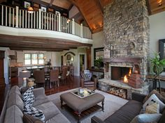 """Clean and simple expressions with the balusters and handrails in the loft, and the mix of wood, stone, and drywall surfaces. This architectural design combines the elegance you might see in a luxury home in Atlanta with the simple earthy textures and colors of a North Georgia Mountain Home. This blending of style, color and textures creates a lifestyle we call """"Modern Rustic Living"""".  More photos and floor plans here: http://www.modernrustichomes.com/design/portfolio/dragonfly"""