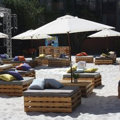 Pallet Seats Used With Sand And Umbrellas Create Awesome Beach Party Theme
