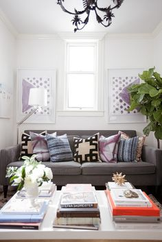oh happy day + furbish, jordan ferney, jamie meares, small san francisco apartment, sofa styling, pillow mix, greek key pillows, painted chandelier, coffee table styling, fig tree