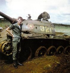 Destroyed NVA T-54 tank Note the AP round right of star..