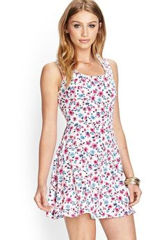 Style Deals - This sleeveless fit and flare dress features an allover floral print and invisible ...