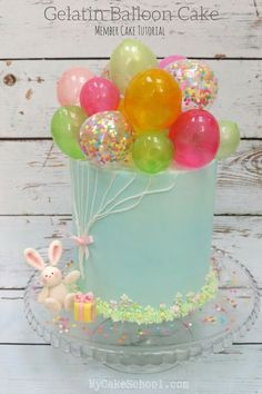 Learn how to make this adorable Balloon Themed Cake featuring colorful Gelatin Bubbles in this member cake decorating video tutorial by MyCakeSchool.com! Perfect for birthday parties!