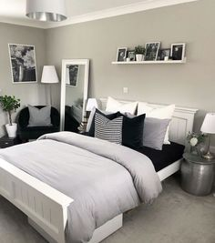 Luxury grey bedroom inspiration, grey and white modern bedroom with picture shelf styling and bedside tables, a reading corner and pillar candlesticks. White Bedroom Design, White Bedroom Decor, Room Ideas Bedroom, Home Decor Bedroom, Bedroom Chair, Bedroom Designs, White Decor, Grey Bedroom Furniture, Bedroom Interiors