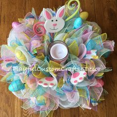 "This Easter Bunny Centerpiece would look absolutely adorable on your table! It has a pink LED color changing battery operated candle that has an egg shape that shows through when lit. Measures 21"" acr"