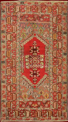 """Stupendous exemplar of the famous Ghiordes rugs. It'a a piece of second half XIXth. from the clear and regular pattern that introduces perfectly symmetrical field and the typical ample hem. Peculiar to Ghiordes the homonym knot, named also """"Turkish knot"""", used in the whole Anatolia, in Caucasus, Persia and Afghanistan."""
