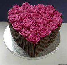 roses on cake ~ I would love this with pastel pink roses.