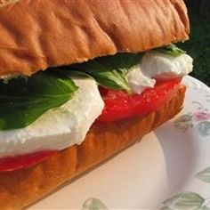 """""""This is a quick and refreshing no cook vegetarian meal. Basil, mozzarella and tomato on Italian bread.  Great for those hot summer evenings when you don"""