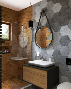 Really curious what your opinion on this bathroom design is! 💭😮 It combines wood with hexagon stones, dividing the shower from the rest of…