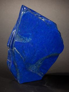RICH BLUE LAPIS LAZULI FREE-FORM Afghanistan This polished piece of Lapis lazuli, formed from the mineral Lazurite, exhibits the intense blue color and subtle characteristics so associated with this coveted rare and semi-precious mineral. Lapis has been prized since antiquity.