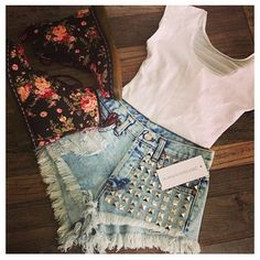 Perfect outfit. Crop top with high waisted studded shorts and floral doc martens