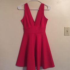 Forever 21 red, V-neck dress Red, V-neck dress. Deep V in both the front and back. Never worn. Size small. Forever 21 Dresses