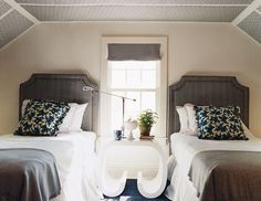 "gray fabric headboard and wallpaper on ceiling surprise in this bedroom ~ paint color ""White Dove"" by Benjamin Moore"