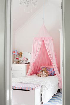child's tent canopy with fabric and wooden ring hung from ceiling....I would love this for girls' shared room, especially with pendant light hung down the middle of the canopy for reading!