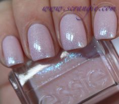 Essie Pink-A-Boo. This is a sheer, cool-toned milky pink base with color-shifting glass fleck shimmer. You can see it very strongly in the bottle, ...