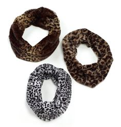 Snuggle up with this soft faux fur infinity scarf in leopard prints of different…
