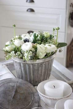 Flowers in old bakeware or jelly moulds