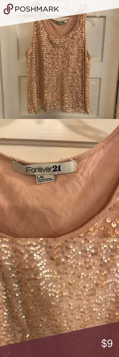 Sequin Tank top Forever 21 rose gold sequin tank top. EUC, I don't see any sequins missing, but there might be a few somewhere! Size Large Forever 21 Tops Tank Tops