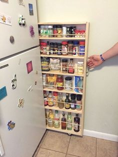 Slip a rolling storage pantry in the extra space next to your fridge.