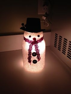Homemade snowman. Fill mason jar with string of 20 lights, cover with a white sock, glue black beads for eyes, orange cotton ball for nose, red ribbon for scarf, black buttons. A.C. Moore has small hats for on top.
