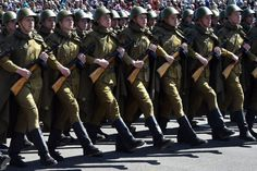 Belarusian Army soldiers dressed in WWII-era Soviet Red Army uniforms marching down Victors' Avenue at the 2015 Victory Day Parade in Minsk, Belarus..
