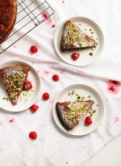 honey almond cake with raspberries, orange, and pistachios
