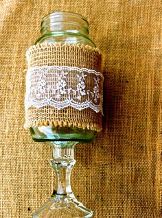"Buralp and Lace ""Hillbilly Wine Glass"" Rustic Mason Jar Centerpieces / Vases. $8.99, via Etsy."