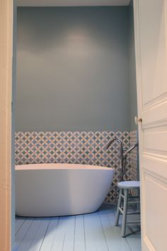 This bathroom is so effortlessly elegant and lovely! The painted wooden floor is gorgeous and the tiles are to die for!