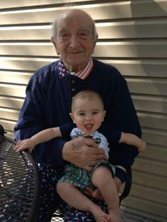 A 100-year-old man with his 1-year-old great-grandson. 99 years apart.