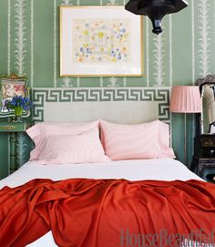 "For designer Joe Nye's Beverly Hills apartment Claremont's George Spencer Palm Stripe was ""a must-have."" He covered the headboard in a dhurrie rug and loaded the room with furnishings, some of them big-scale pieces like a buffet by Frances Elkins and a 19th-century lantern from Hollyhock."