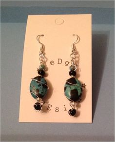 Turquoise and black oval bead and black bead wire wrap drop earrings