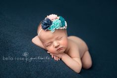 Newborn girl criss-cross pose navy blue, aqua, teal, gold, and blush  |  Bella Rose Portraits San Diego County newborn and baby photographer photography posing techniques Oceanside, CA