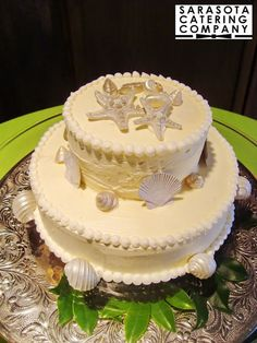 Beautifully simple and elegant white shell Wedding Cake with Buttercream frosting.
